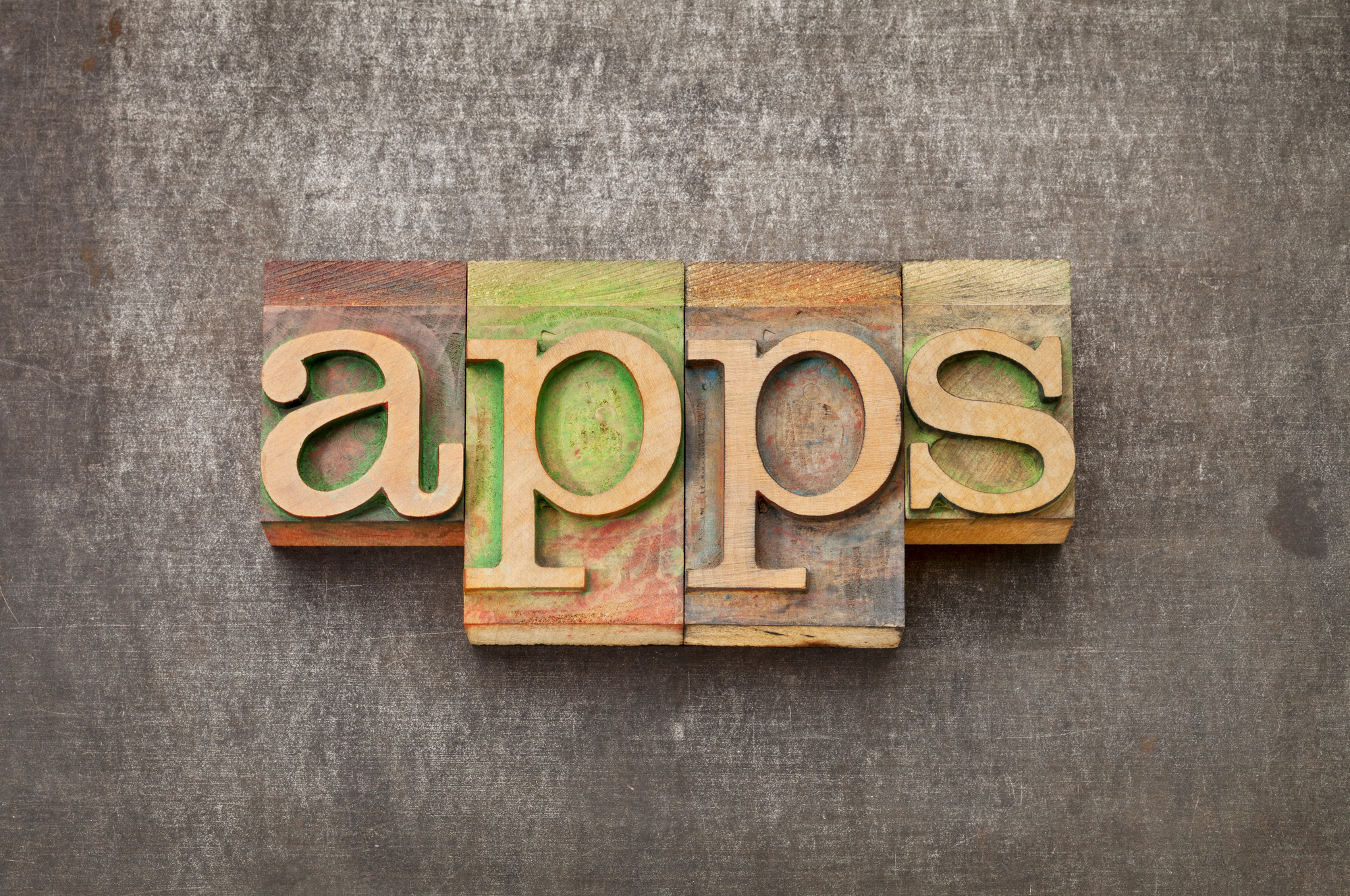 Multi-Family Property Mobile Apps in Wood Letters On Background