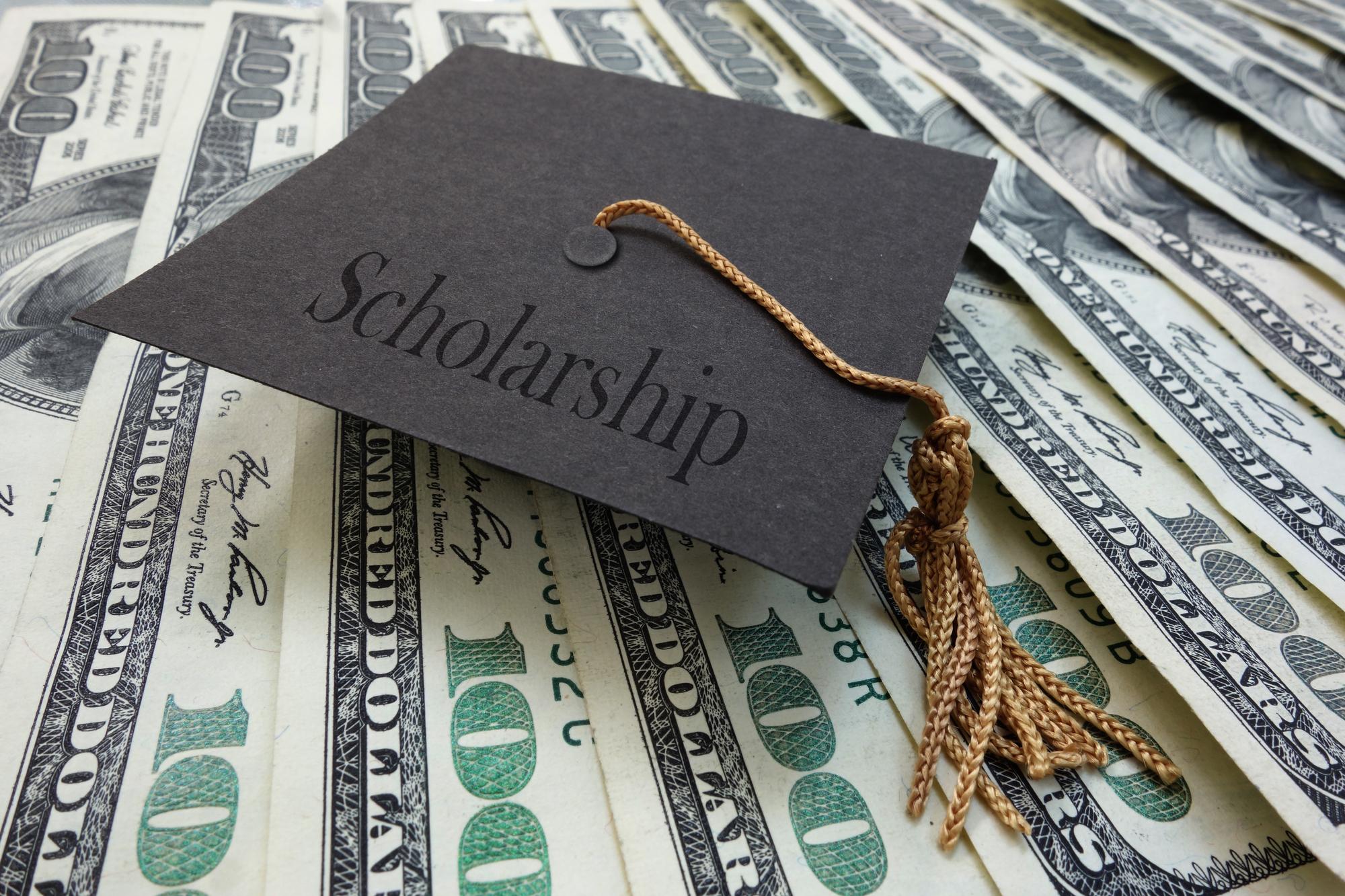 NAHMA Scholarship Represented by graduates cap on money background