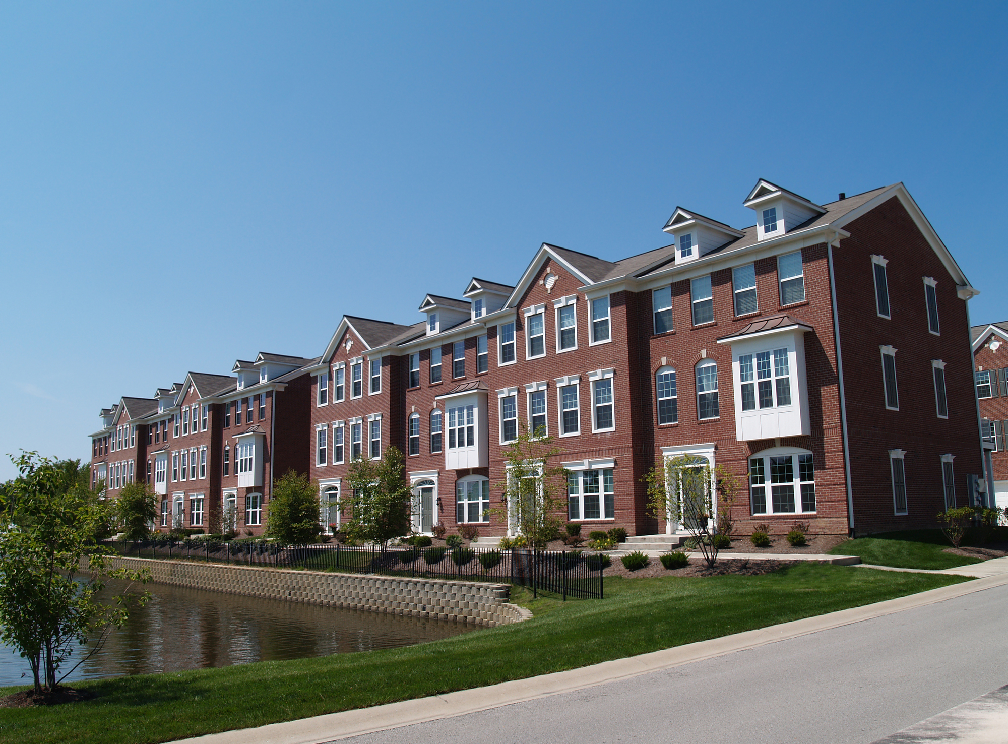 brick townhomes and condominium managed by an accredited residential manager