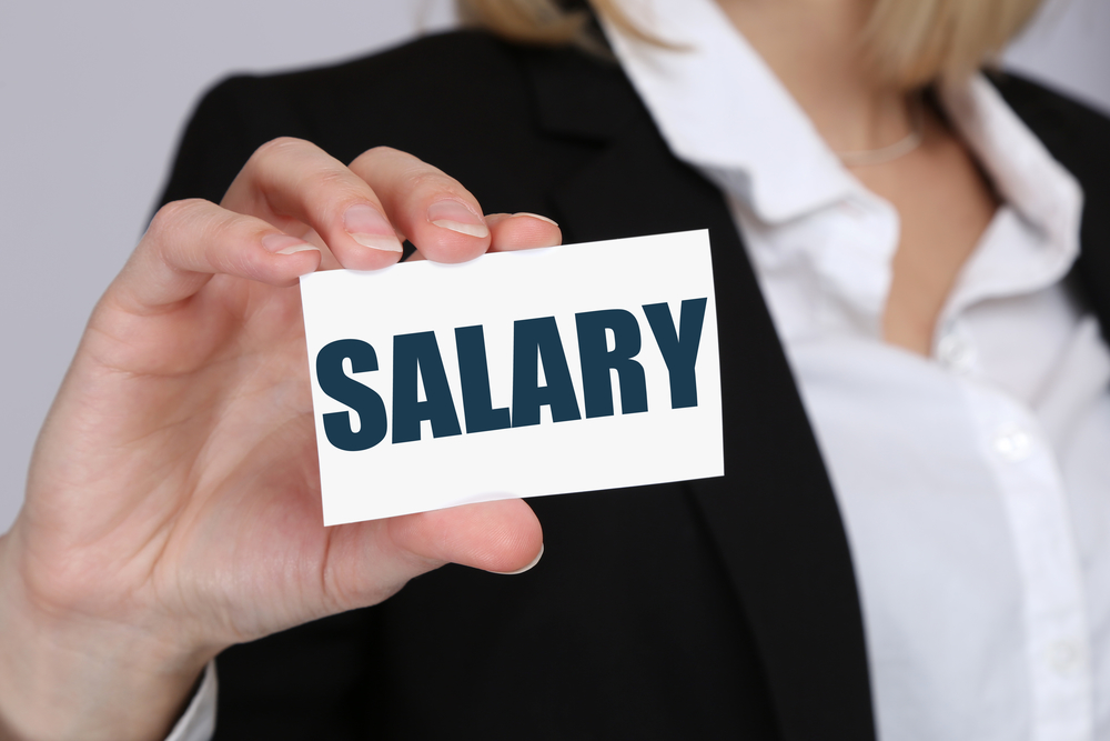 Apartment Manager Salary On Business Card Held By Business Woman
