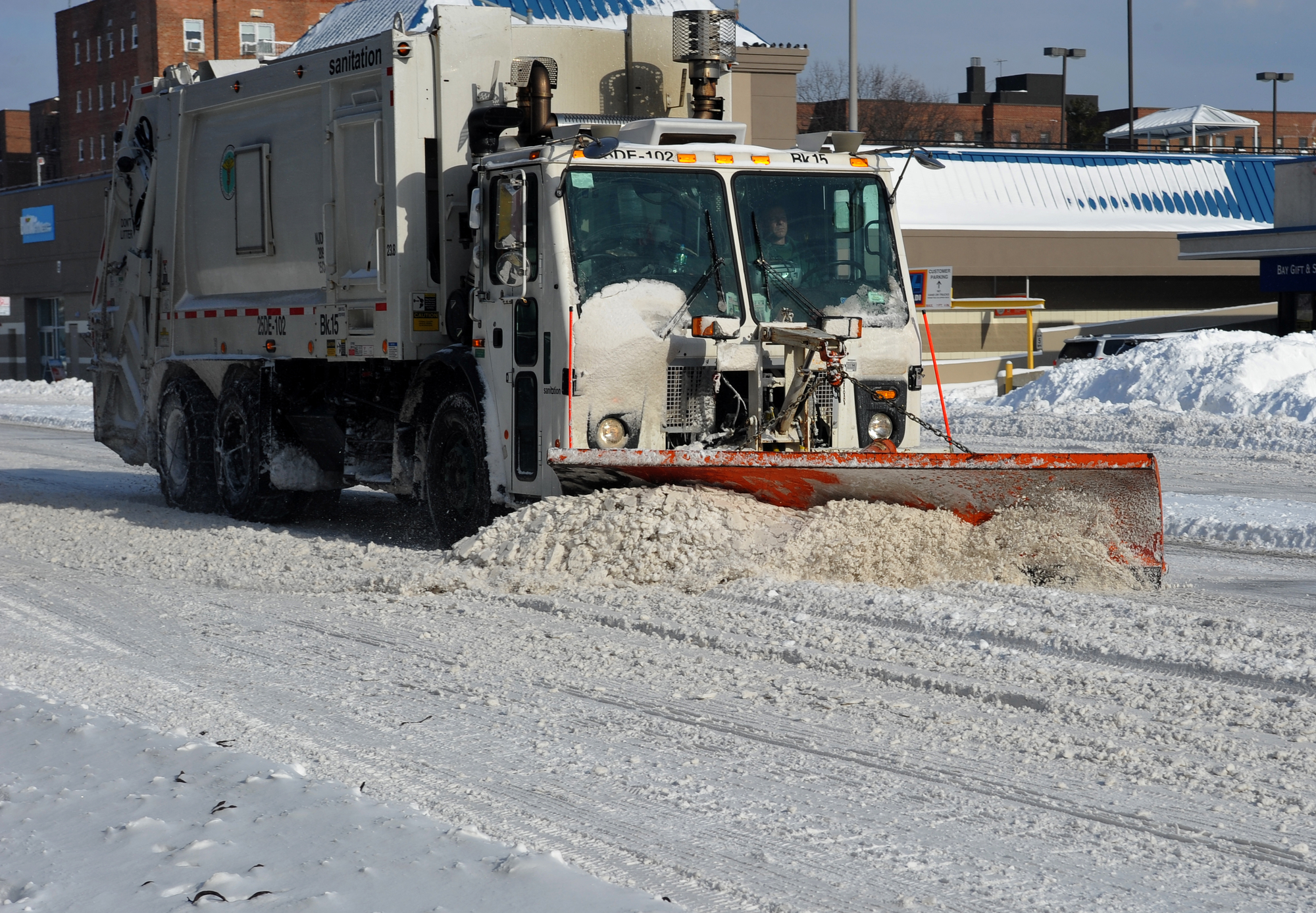 Snow Plow on City Street For How to prepare a TPO roof for winter