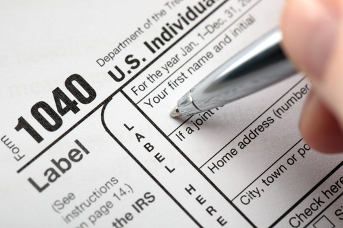 Federal Tax Return Document With Pen